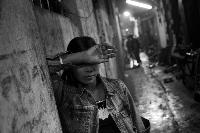 A sex worker  in the Sheth Bagan red light area adjoining Sonargachi in Kolkata, West Bengla, 2008.