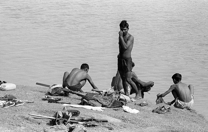 Gang members bathe in the river, 1982.