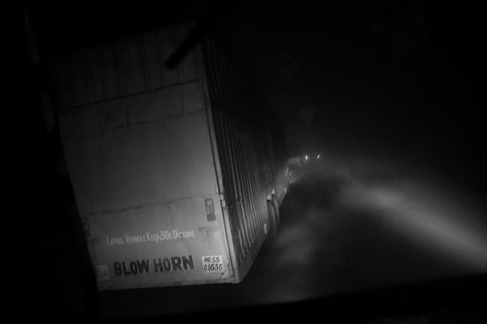 Trucks ply on National Highway # 31 between Siliguri and Dalkhola, West Bengal, 2008. Truckers are a high-risk group.