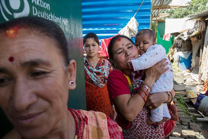 Women gather at a Female Friendly Space for distribution of Dignity Kits at Bungamati, Kathmandu, Nepal, 2015.