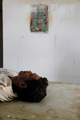 The body of Vijay Thamke, a farmer from Sonbardi village who committed suicide, lies in the mortuary of the Pandharkawada district hospital awaiting post mortem.