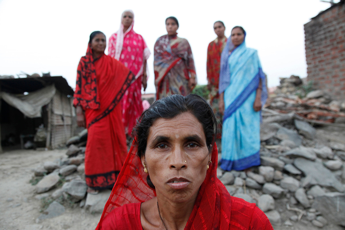 Rajni wife of Arun Tupatkar, a farmer of Pimpri Kalga village who committed suicide, with other farmer suicide widows of the village standing behind her.