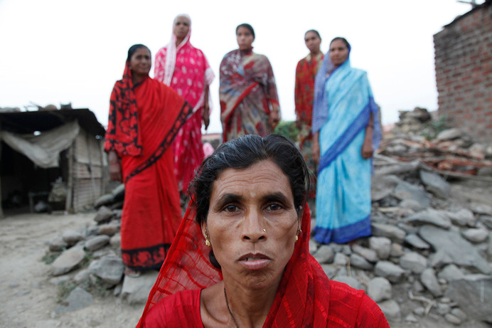 Rajni wife of Arun Tupatkar, a farmer of Pimpri Kalga village who committed suicide, with other farmer suicide widows of the village standing behind her.