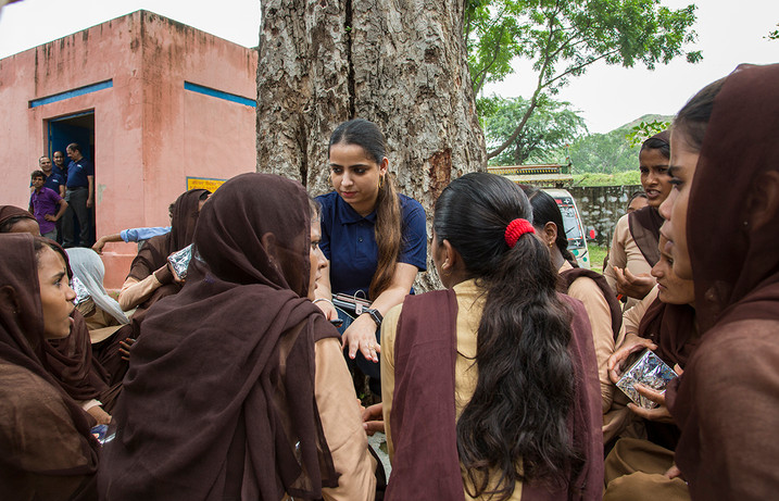 A Kohler staff member counsels girl students on hygience at the Government Middle School at Khori village in Alwar district, Rajasthan, India under Kohler Stewardship's School Sanitation Project, 2018.