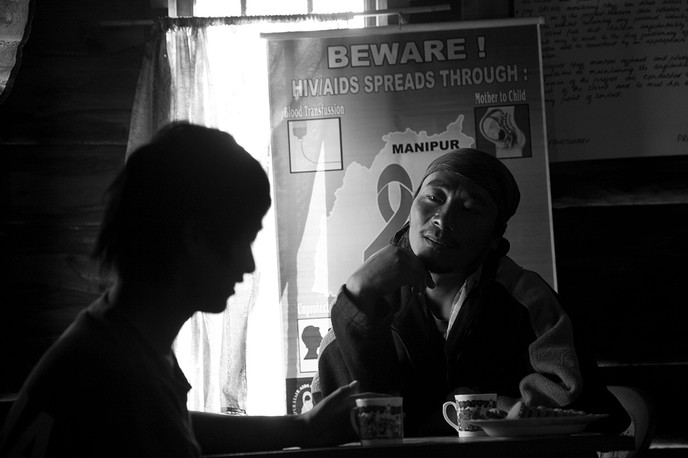 Graceson, former IDU and Orchid project's Out Reach Worker, counsels a client at the DIC in his home Shirui village, Ukhrul, Manipur, 2007.