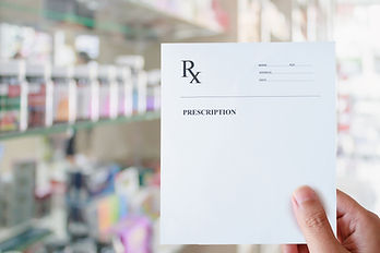 Pharmacist hold blank prescription in ph