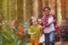 Dolphin Kids™ running and playing outside in nature as part of the Dolphin Kids™ Achievement camps and programs in Vancouver, BC based on the Dolphin Kids™ philosophy of Play, Others and Downtime founded by child expert and psychiatrist Dr. Shimi Kang.