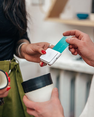 merchant-taking-sale-with-chip-and-swipe