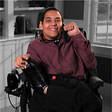 Male caller siiting on wheelchair