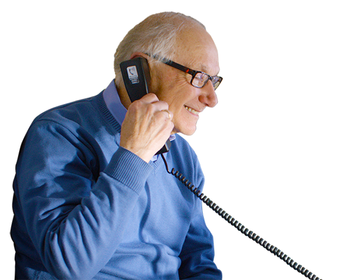 A man with a hearing loss enjoys reading captions on the CapTel's phone screen.
