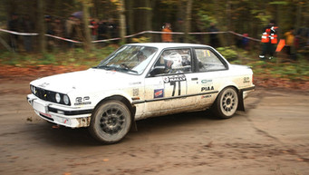 Our very own E30 being used as the lead car on the RAC Rally