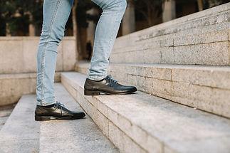 modern-and-stylish-businessman-walking-u