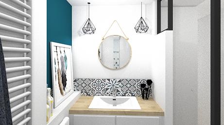 vue de face de la salle de douches de la suite parentale rénovée sur sol chauffant à railleur la pape avec grand miroir rond  et carreaux ciment avec la présence d'un mur en bleu canard