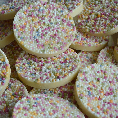 White chocolate flavoured discs topped with crunchy candy