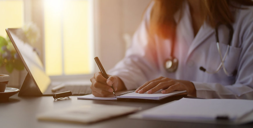 close-up-view-young-female-doctor-writing-medical-charts-with-tablet-office-room.jpg