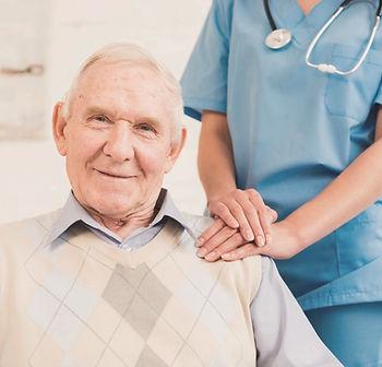 caregiver-holding-old-man-s-shoulder_edi