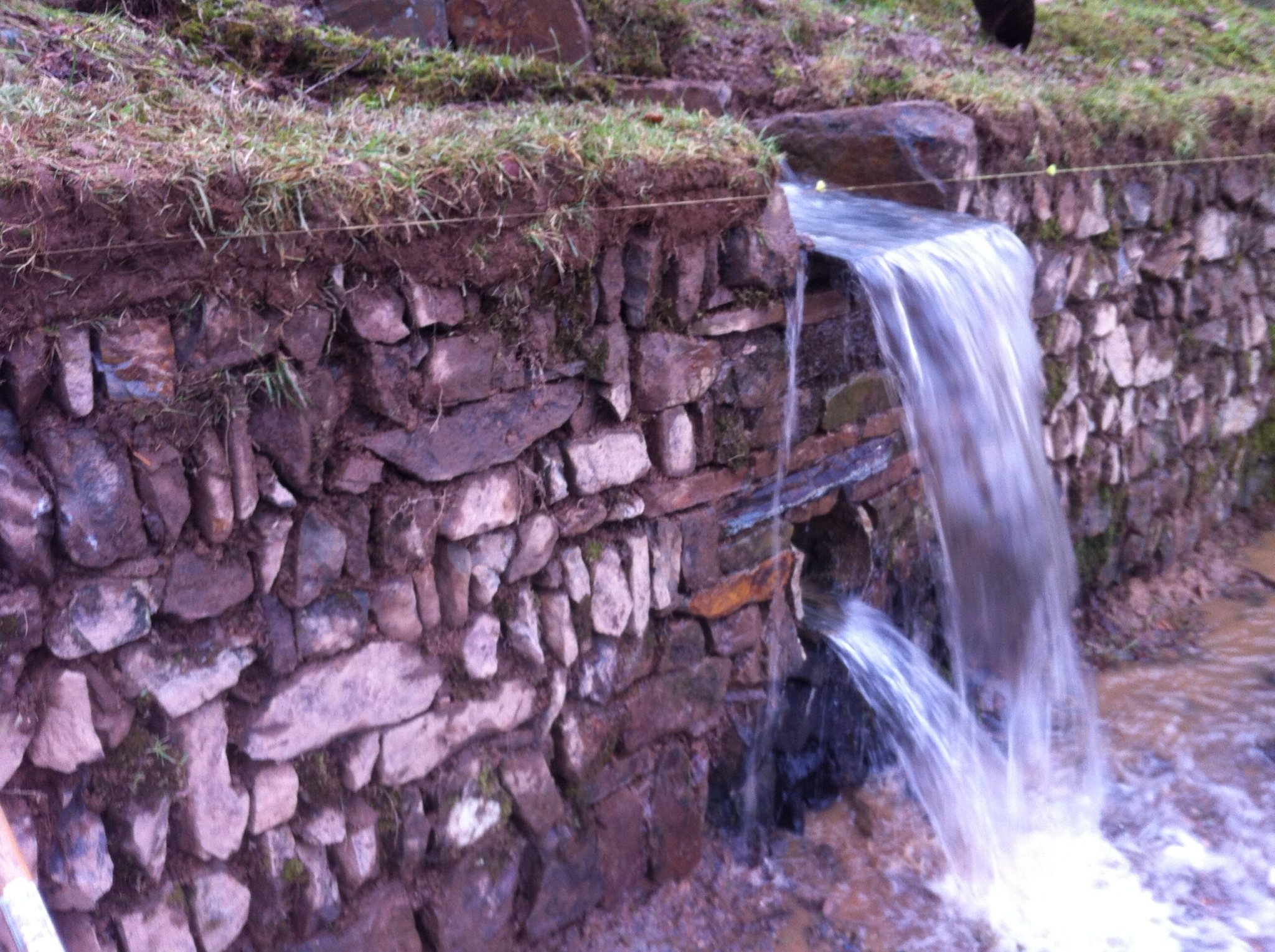 Stone field drain with overflow.jpg