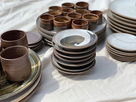 fdpottery-stack of swirled plates with s