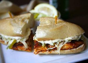 Blackened Fish Sandwich with  Garlic Aioli & Lemon, Dill Slaw