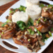 """Asian spiced, thick cut pork chops baked, drizzled with a spicy garlic, ginger sauce and topped with sautéed mushrooms, shallots and Bok Choy cabbage"""