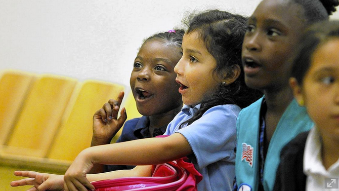 In Watts, a Girl Scout uniform levels playing field for young girls