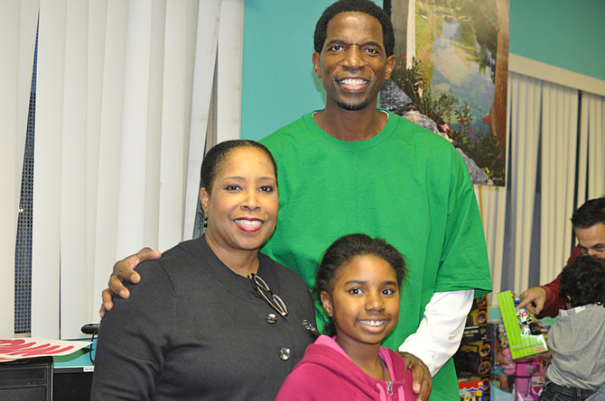 Former Laker, AC Green, passes out hundreds of toys to public housing youth