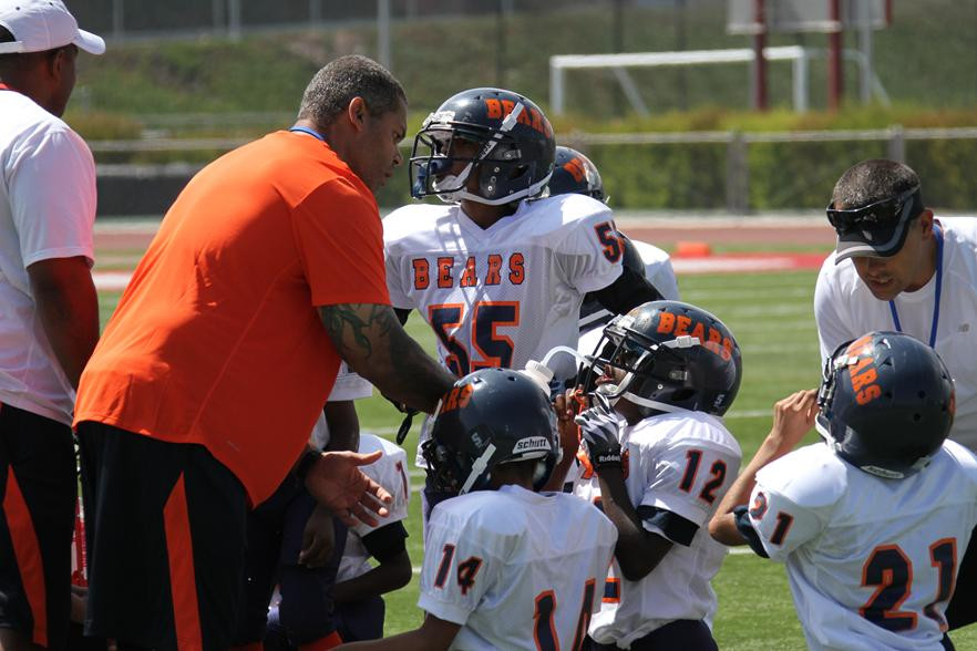 LAPD Officers coaching Youth Football