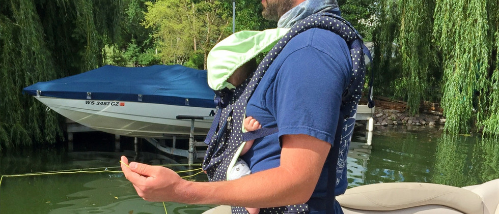 Fly Fishing with Baby Carrier.jpg