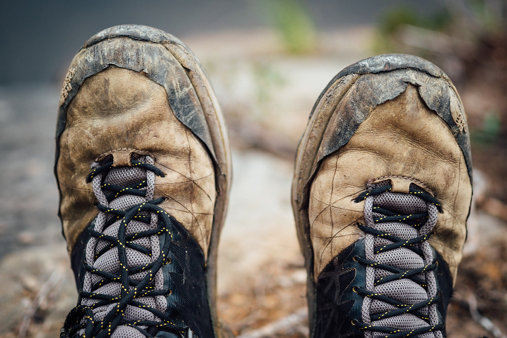 Photo of dirty hiking boots symbolizing the importance of being prepared to build a company.