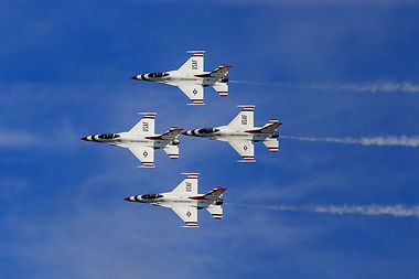 Image of the USAF Thunderbirds in formation flying. Shows the importance of alignment and constant communication in business.
