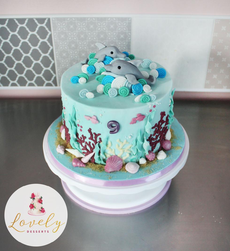 Gâteau d'anniversaire thème dauphins - mer