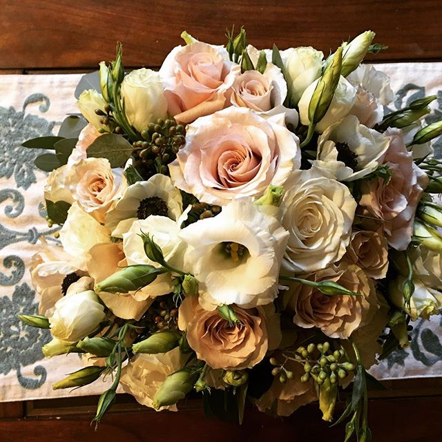 Pretty combination of ranunculus, roses,