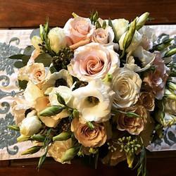 Pretty combination of ranunculus, roses,