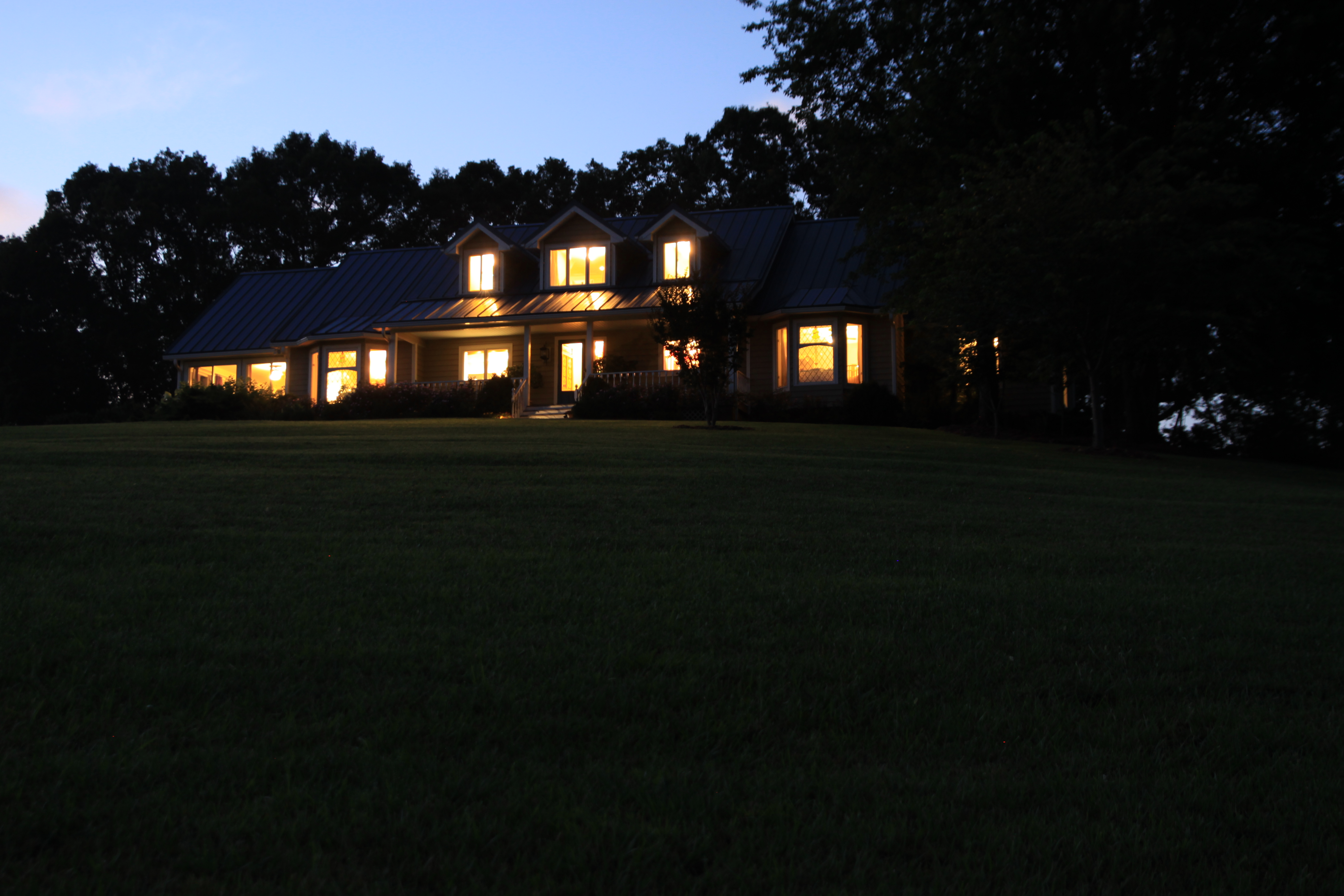 front view of house at dusk