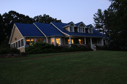 sideview of the house at dusk