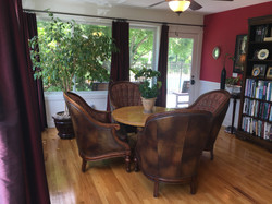 sun room table and overstuffed chairs