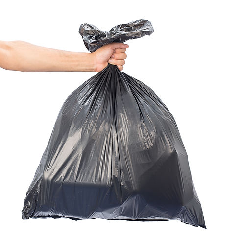 Man hands holding garbage bag isolated o