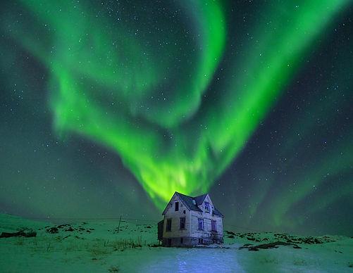 Northern light above a spoky house