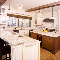 A second sink, a counter for guests and an island for the cook.
