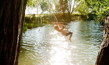 a rope swing over the river on The Norfolk Broads