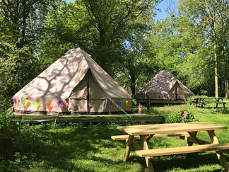 woodland bell tents for glamping at swattesfield campsite in suffolk