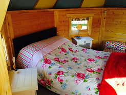 inside Swattesfield Pixie Hut with a bed made up