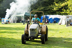 tractor delivering supplies to campers at swattesfield campsite