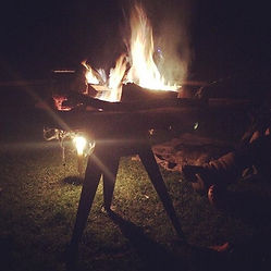 a fire pit at night on the campsite