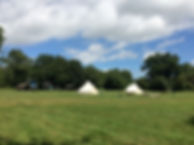 view over swattesfield campsite glamping options with bell tents and pixie huts