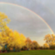 rainbow over swattesfield campsite and the pixie huts and suffolk hay cart