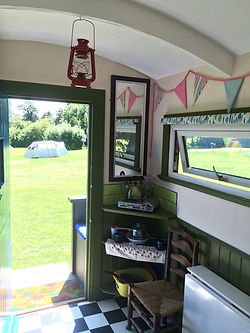 inside the Suffolk hay cart / shepherds hut at swattesfiel campsite