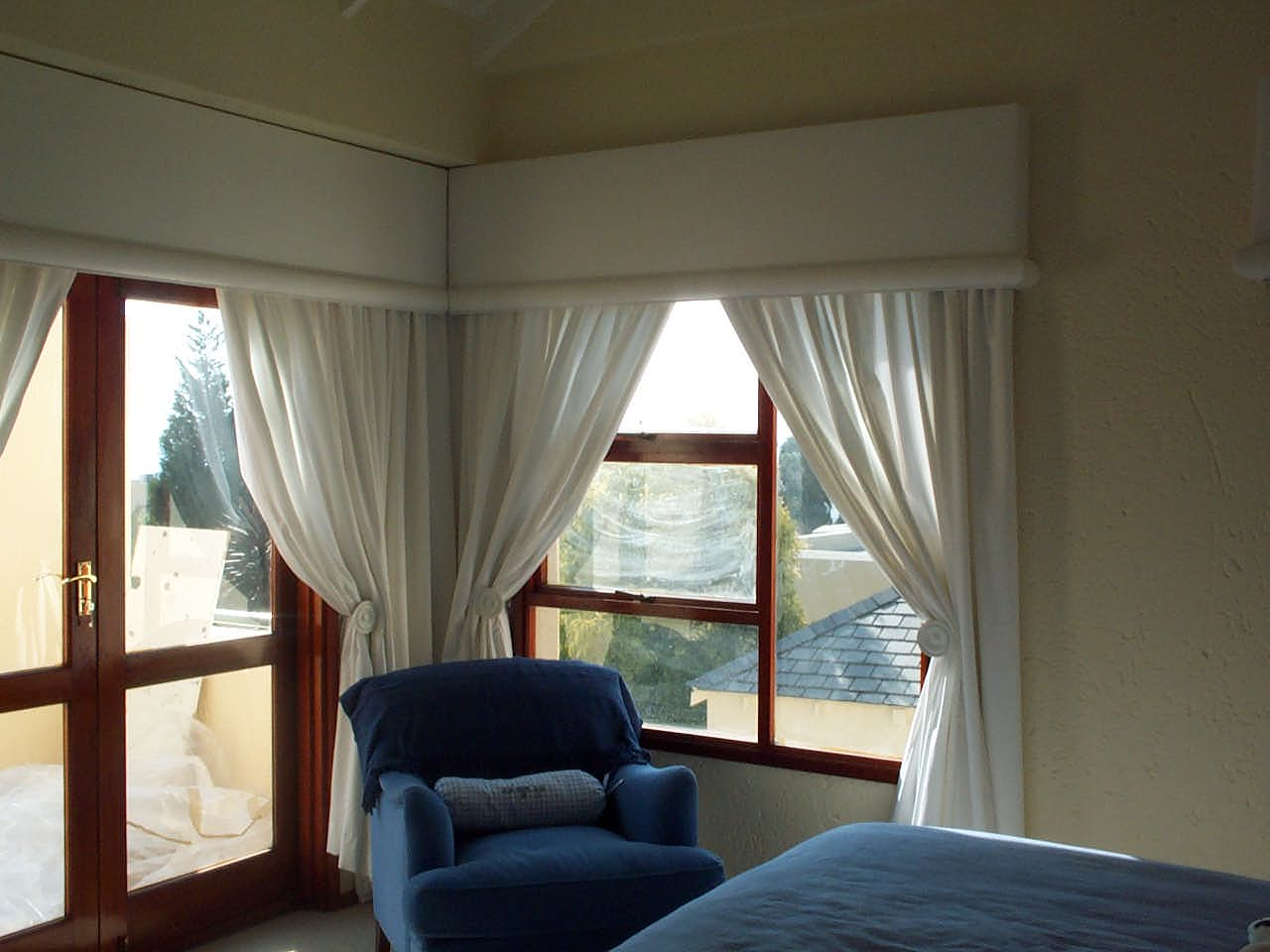upholstered armchair and curtains