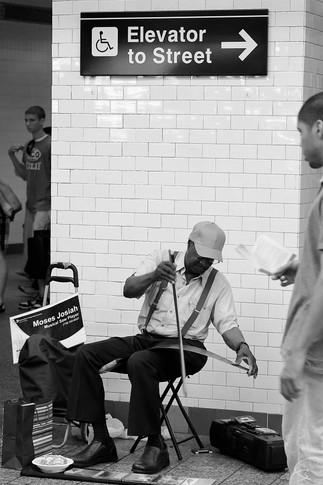 Saw Player, New York 2011