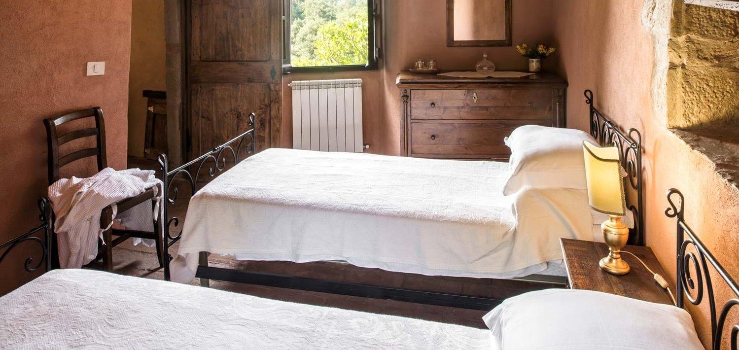 borgo-san-biagio-twin-bedroom-1